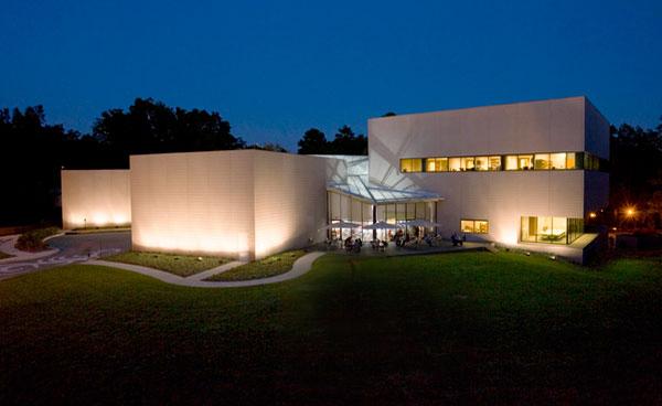 Museum exterior seen at night.'